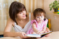 Mom and kid girl read a book Stock Photo