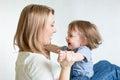 Mom and kid having fun pastime. Parenthood Royalty Free Stock Photo
