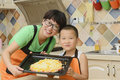 Mom and kid making pizza Royalty Free Stock Photo