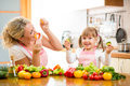 Mom and kid preparing healthy food mother Royalty Free Stock Photos