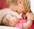 Mom looks with love at child parenthood happiness mother conception Stock Photography
