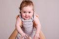 Mom raised over little girl Royalty Free Stock Photo