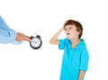 Mom showing kid clock that it is time to go to bed he doesn t like that closeup portrait of isolated on white background Royalty Free Stock Photos