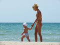 Mom and son at the beach summer Stock Photography