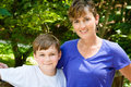 Mom and son together outside on sunny day a mother happy a Royalty Free Stock Photo