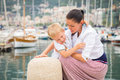 Mom and son on the waterfront a beautiful summer day leisure at sea beautiful yachts water Stock Image