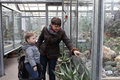 Mom tells son about cacti her at a botanical garden Stock Photo