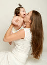 Mom throws baby baby and kiss, play and having fun Royalty Free Stock Photo