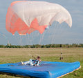 Moment of the girl-parachutist landing Stock Photography