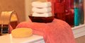 Mommies shelf bathroom with feminine soaps perfumes a bath towel and a sponge Royalty Free Stock Image
