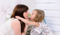 Mommy and daughter face to face young little indoors Stock Images