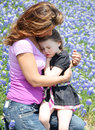 Mommy hug little girl is sleepy and wants her mother to hold her Stock Images