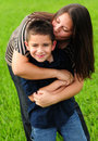 Mommy kissing son Royalty Free Stock Images