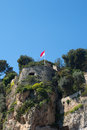 Monaco flag on coast Royalty Free Stock Photos