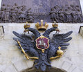 Monarchy symbol over gate of the peter and paul fortress Royalty Free Stock Photos