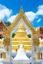 Golden monastery gate beautiful in Thailand temple. Royalty Free Stock Photo