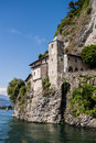 Monastery of santa caterina by lake maggiore italy the is perched on a cliff on the edge leggiuno Stock Image