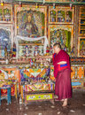 Monch inside the bon monastery a yung drung kundrak ling near ravangla india is offering food to buddha relegion is older Royalty Free Stock Image