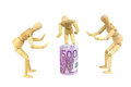Money adore wooden figures symbolise the adoration of the Royalty Free Stock Image