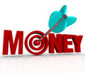 Money arrow in target bulls eye earn riches reach goal the word d red letters and an shot into the center to represent earning Stock Photo