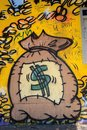 Money bag and coins graffiti with dollar singe Stock Photos