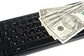 Money on black keyboard isolated on white background Stock Photo