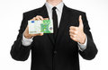 Money and business theme a man in a black suit holding a bill of euros and shows a hand gesture on an isolated white backgrou Stock Images
