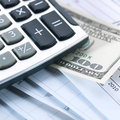 Money and calculator Royalty Free Stock Photos