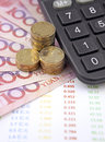 Money and calculator with charts on desk Royalty Free Stock Photo