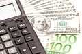 Money and calculator over white business picture selective focus Stock Photos