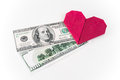 Money can buy love heart and money on white isolated background Royalty Free Stock Image