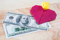 Money can buy love heart ring and money on white isolated background Stock Photo