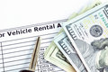 Money & car key on Vehicle Rental Agreement paper Royalty Free Stock Photo
