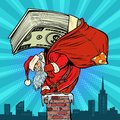 Money cash dollars. Santa Claus with gifts climbs into the chimn