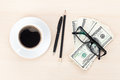 Money cash, glasses, pen and coffee cup Royalty Free Stock Photo