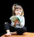 Money child with euro on black background Royalty Free Stock Photo