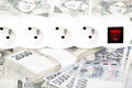 Money concept of expensive energy bill power cord and banknotes czech crowns Stock Image