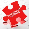 Money concept: Investment Banking on puzzle background Royalty Free Stock Photo