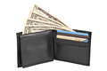 Money and credit cards in black leather purse isolated on white background Royalty Free Stock Photo
