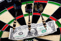Money on dartboard Royalty Free Stock Photography