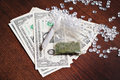 Money in drugs illegal trade with marijuana paid by dollars and diamonds Stock Images