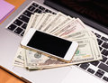 Money and electronic devices Royalty Free Stock Photo