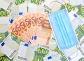 Covid with euro money bills and face mask Royalty Free Stock Photo