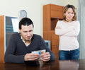 Money in family man counting cash women watching him Royalty Free Stock Photography