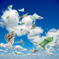 Money flying out of the sky euro and dollar bills are on blue Stock Image