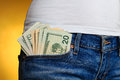 Money in front pocket in women's jeans Royalty Free Stock Photo