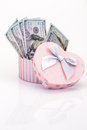 Money in gift box american dollars a heart shaped Royalty Free Stock Photos