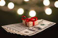 Money gift box and us dollar bills Stock Photo