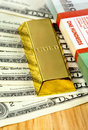 Money and gold bullion Stock Image
