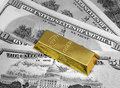 Money and gold bullion Royalty Free Stock Images